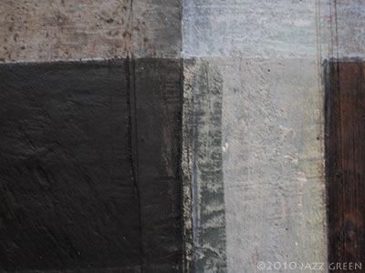 close-up of abstract painting on wood - grey brown texture