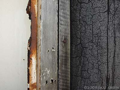 photograph of weathered wood - rust white crackled grey paint