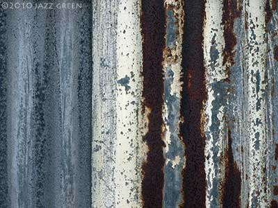 photograph of rusty metal corrugated iron - brown blue grey