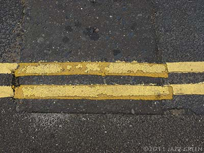double yellow lines painted on the tarmac - abstract art