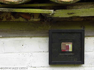 small abstract fragments collage hanging on the shed wall