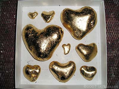 gold heart pebbles in a box