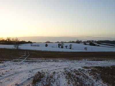 snow over fields and hill