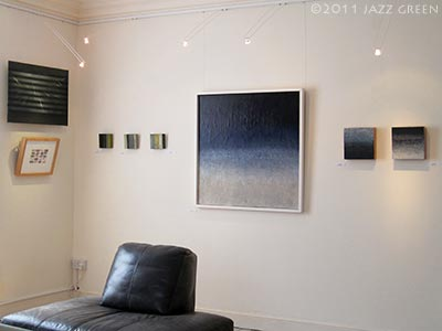 large abstract painting, meld rain by jazz green and two small abstract paintings on wood - harleston gallery