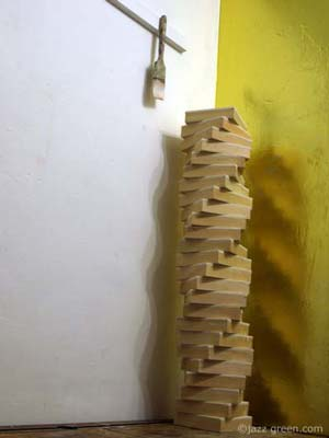wood panels piled up - twisting spiral column - sculpture, artist studio - a new arrangement