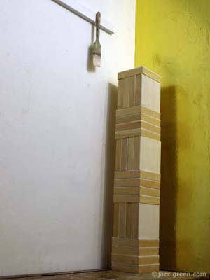wood panels stacked up - upright column - sculpture - artist studio