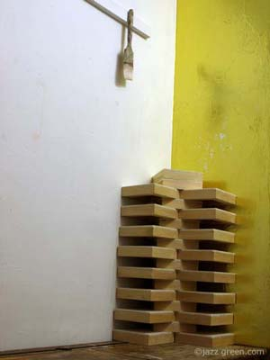 architectural formation of square wood blocks, painting panels - sculpture in the studio