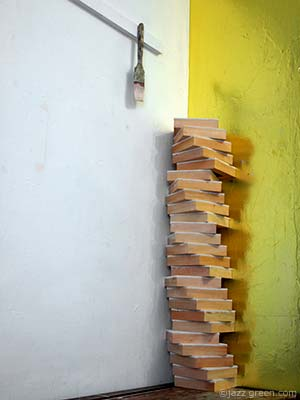 wood panels stacked up - a twisting, spiralling column - sculpture - art studio