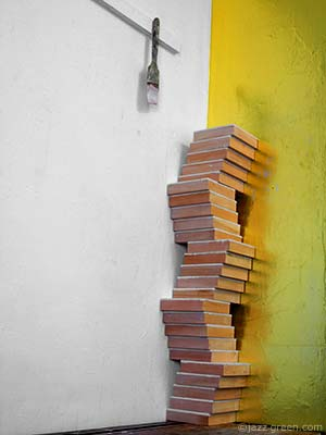 25 square wood panels, stacked up in art studio - sculptural twists