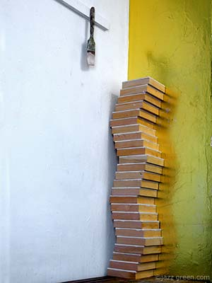 wood panels stacked up in artist studio - zig zag column