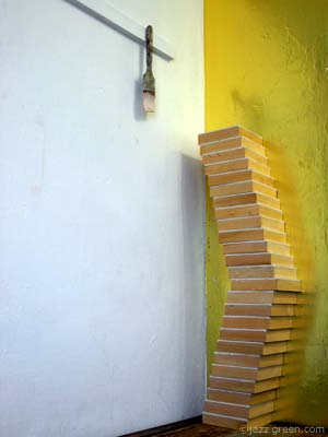 painting panels for salthouse art exhibition - leaning stacked wood tower