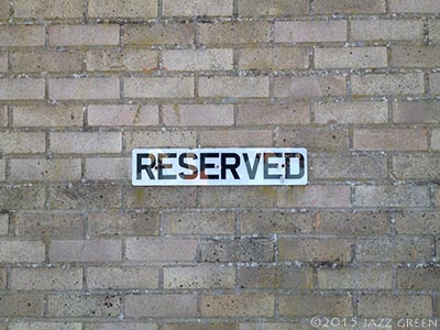 reserved-parking-sign-brick-wall