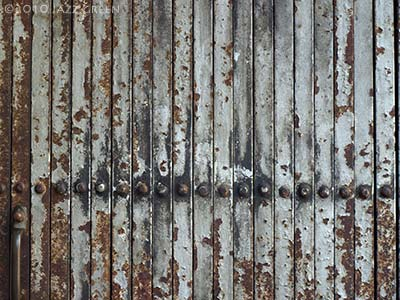 photograph of old rusty metal shutters - brown rust grey