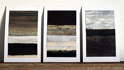 three small abstract paintings on postcards