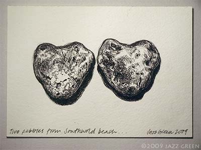 a drawing of two heart-shaped pebbles